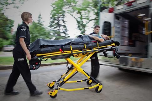 EMT pushing stretcher