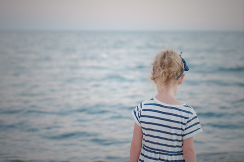 child walking on beach alone