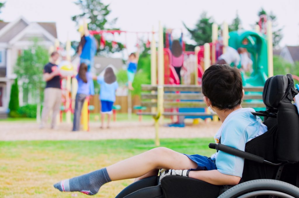 child with cerebral palsy at playground