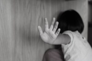 child stopping physical abuse attack