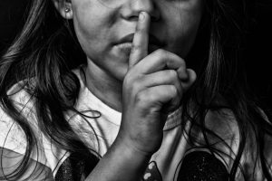 child staying quiet about abuse